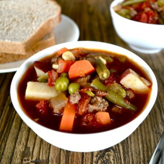 This ground beef and vegetable soup recipe is so hearty and tasty. It has tons of vegetables and I use grass-fed ground beef to ensure that it's healthy. This soup freezes well and it's easy to make a huge batch for a big group. | twothirdscup.com