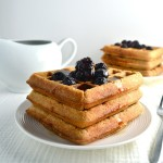 Sprouted Whole Wheat Waffles - This recipe has no refined flour or sugar. It includes ingredients like sprouted whole wheat flour, applesauce, and maple syrup. Make these easy waffles and then freeze the extras for a quick breakfast on rushed mornings. | twothirdscup.com