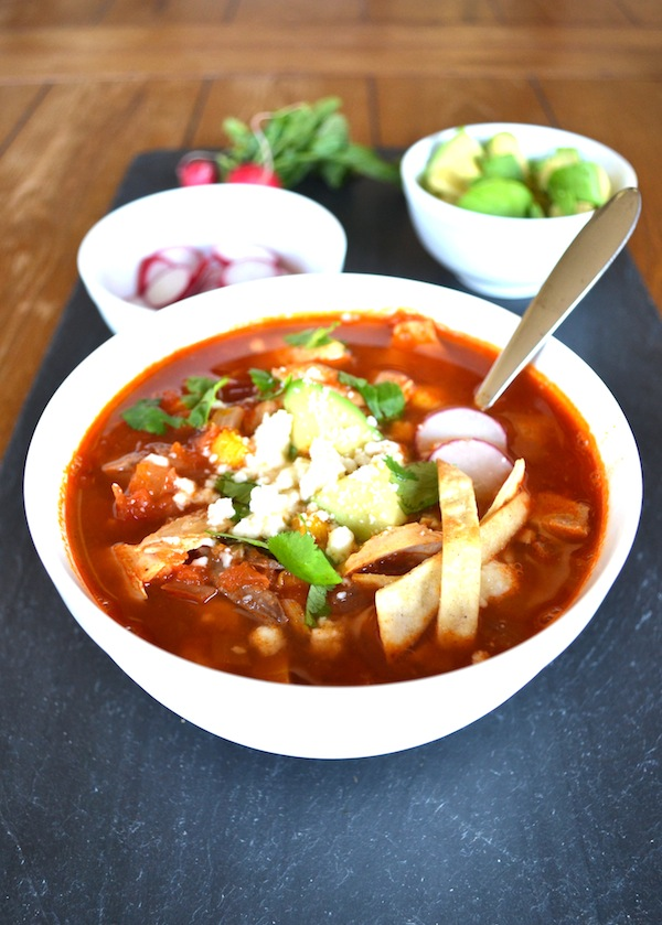 Chicken Tortilla Soup - This authentic recipe uses hominy, queso fresco, and homemade chicken bone broth to create a healthy and delicious soup. It's easy and everyone loves it because they can choose their own toppings!   twothirdscup.com