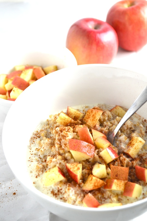 Apple Cinnamon Steel Cut Oatmeal. Top your oatmeal with fresh apples, cinnamon, maple syrup, and cream for a delicious and healthy breakfast. | twothirdscup.com