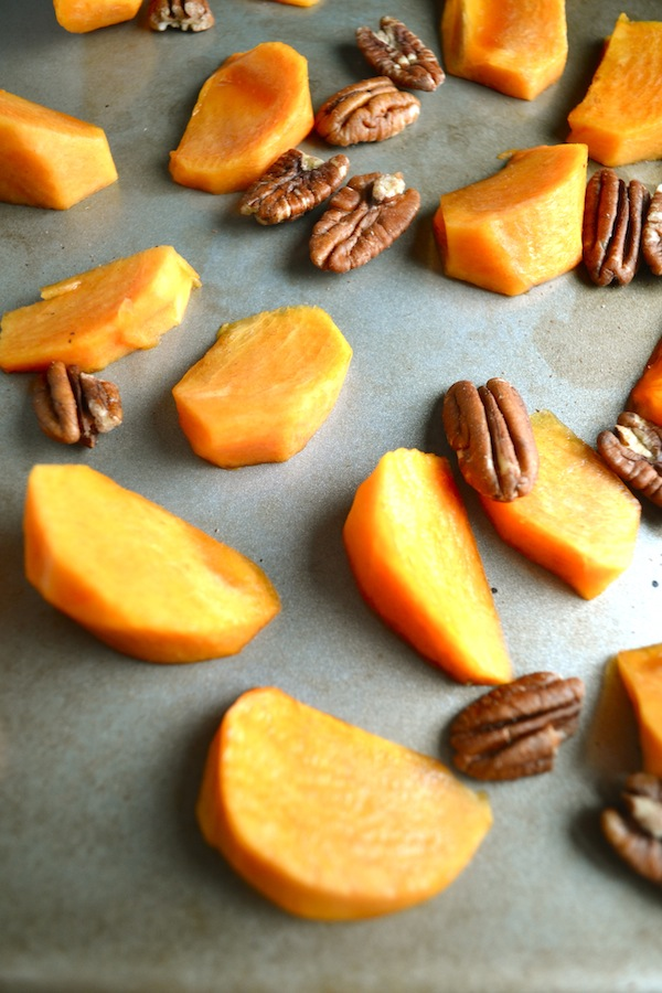 This persimmon, pecan, and cinnamon oatmeal is a healthy and delicious breakfast. Broil the persimmons in the oven for a sweet and unique addition to your morning oats. | twothirdscup.com