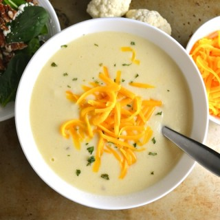 Cauliflower Cheese Soup - A copycat recipe from Zupas with some adaptations. I love this creamy and healthy soup. Use raw cheddar and raw milk for some added probiotics. This recipe is so easy and so delicious! | twothirdscup.com